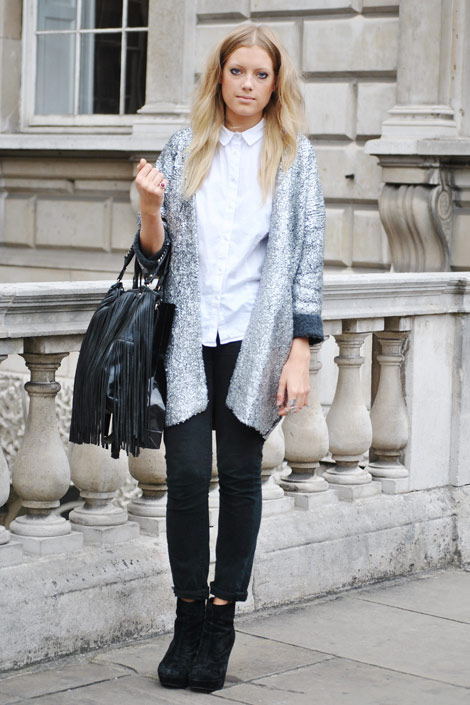Holly White matches her metallic H&M jacket with understated black vintage trousers, and Kurt Geiger booties.